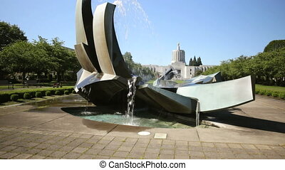 State Capitol Building - Jib shot of fountain and grounds in...