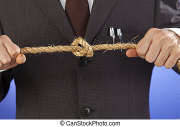tie knot - stock image of businessman tying knot
