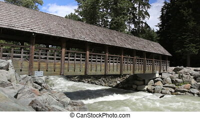 Covered Bridge - A pedestrian covered wooden bridge,...