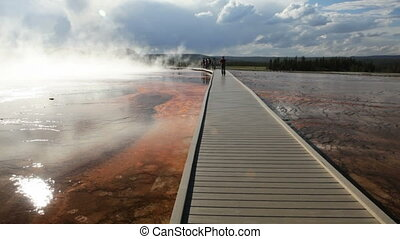 Tourist on the Yellowstone Boardwalk - Boardwalk through the...