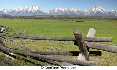 Grand Tetons and split rail fence 2 - Dolly shot of...