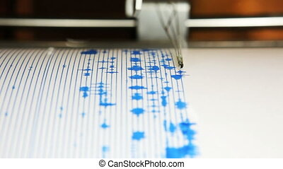 Seismograph - A seismograph machine actively recording...
