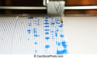 Seismograph - A seismograph machine actively recording...