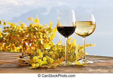 Twho glasses of wine and bunch of grapes. Lavaux region,...