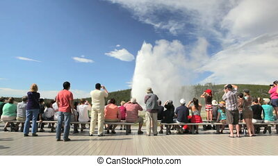 Visitors at Old Faithful Geyser - Populated boardwalk at Old...