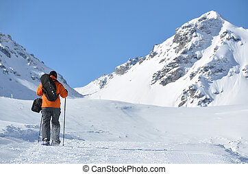 Hiking in snowshoes along the mountain track