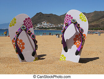 Flip-flops in the sand of Teresitas beach Tenerife island,...