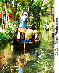 Kerala - Houseboat tour through the backwaters of Kerala,...