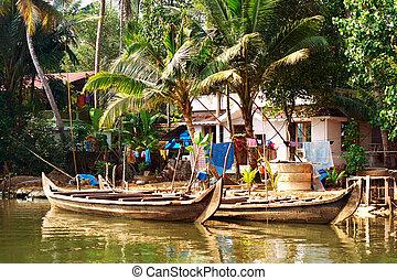 Kerala - Houseboat tour through the backwaters of Kerala,...