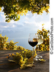 Pair of wineglasses and bunch of grapes Lavaux region,...