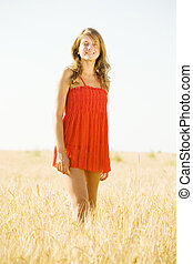 oung woman in wheat field - Happy young woman in the wheat...