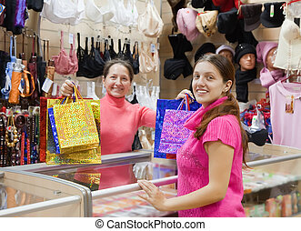 Salesman and buyer at  counter