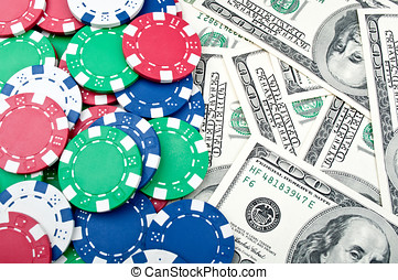 poker chips and dolars on a background