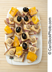 bit with cheese and olives on a wooden background