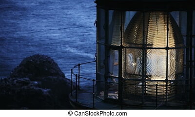 Heceta Head Lighthouse - Close up of the lens lit up and...