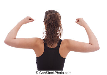 Stretching - A young female dressed in black gym top facing...
