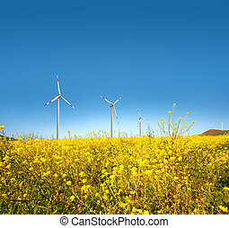 Wind turbine in a yellow field