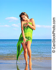 happy woman with sarong - happy woman with green sarong...