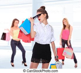 Beautiful shopping women with colorful bags