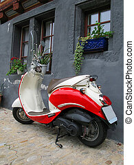 Trendy moped against old building Fribourg, Switzerland