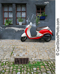 Trendy moped against old building. Fribourg, Switzerland