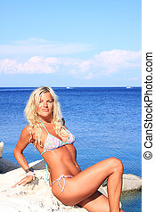 Young beautiful woman posing on the beach - Young beautiful...