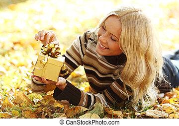 woman take autumn gift