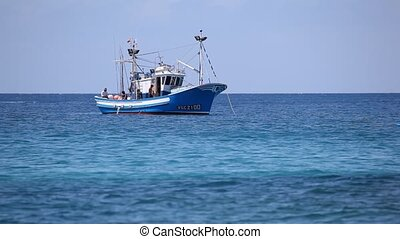 Fishing boat fishes at the coast of Canary Island...