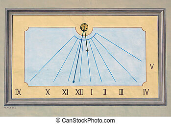 Ancient sundial on the wall of the church in Madonna del...