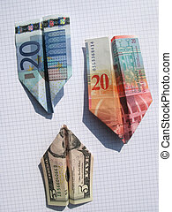Three paper airplanes made of euro, dollar and swiss frank