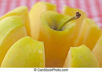 Apple - Closeup with shallow depth of field of a cut yellow...