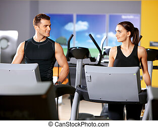 Couple at the gym - Sporty couple exercising at the fitness...