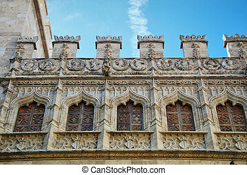 Gothic buildings - Windows on the wall of historical...