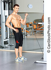 Man at the gym - Handsome man at the gym doing exercises