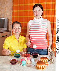 women coloring easter eggs