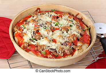 Deep Dish Pizza - Sausage and mushroom pizza in a deep dish