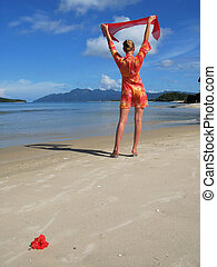 Young woman on a sandy beach Langkawi, Malaysia