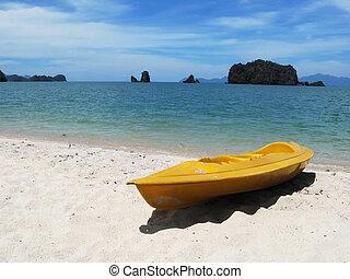 Yellow kayak on the famous Tanjung Rhu beach of Langkawi,...