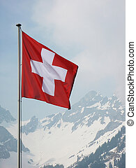 Swiss flag agains snowy Alps
