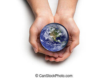 Hands caring for the Earth