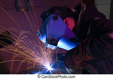 MIG welding close up - Welder uses MIG torch to make sparks...