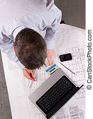 Architect examines plans - Architect or engineer calculates...