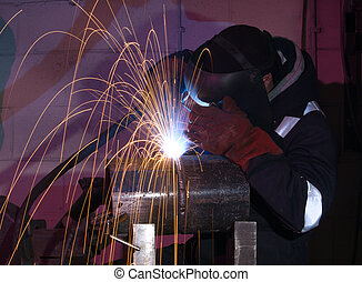 Steel tube MIG welding - Welder uses torch to make sparks...