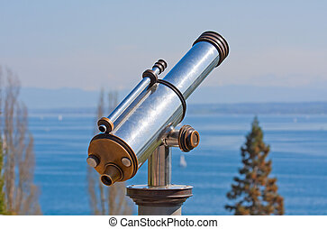 Vintage observation telescope over the sea