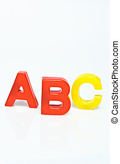 plastic letters ABC on white background