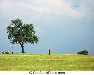 Flying a kite in stormy sky