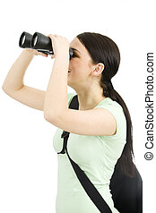 Tourist - young woman holding a binoculars