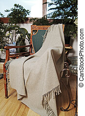 Throw draped over an antique chair