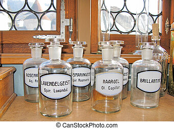 Empty scent bottles on the shelf in an old pharmacy