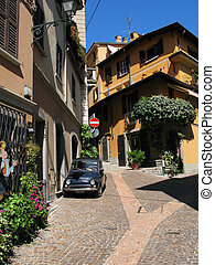 Narrow street of Menaggio town at the lake Como Italy